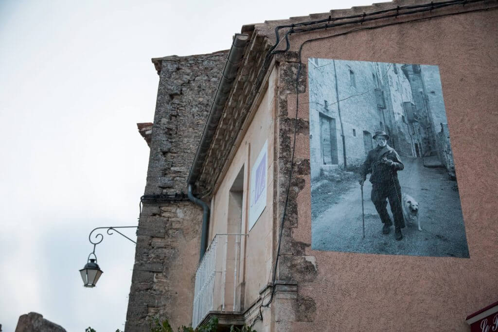 Local photographic history adorns the walls of Gordes