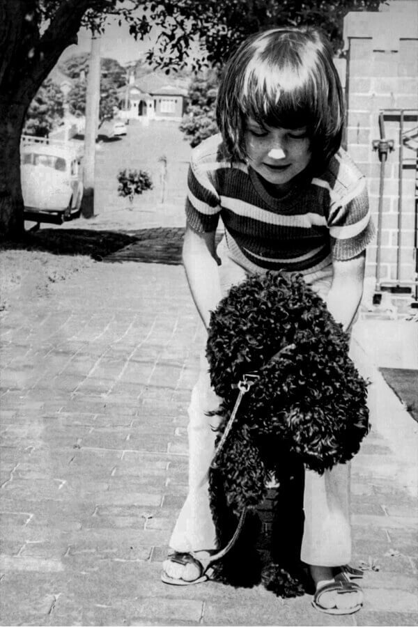 Jo Lyons as a kid and Patsy the black poodle